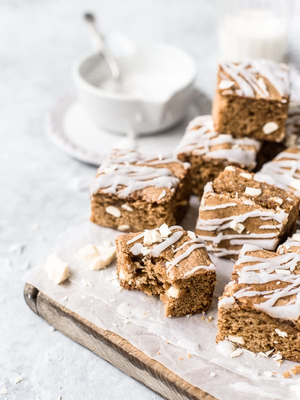 White Chocolate Browned Butter Blondies drizzled with glaze by Emma Duckworth Bakes