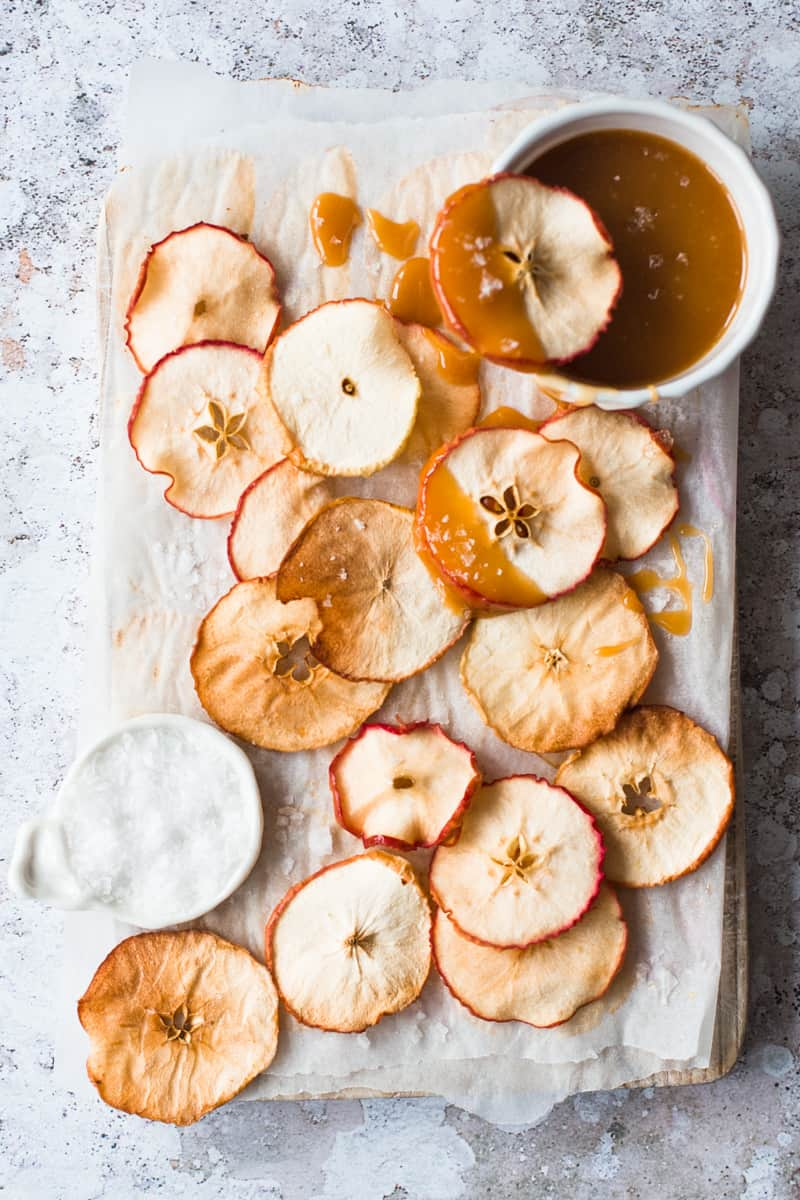 Finely sliced and baked Apple Chips dipped in salted caramel sauce by Emma Duckworth Bakes
