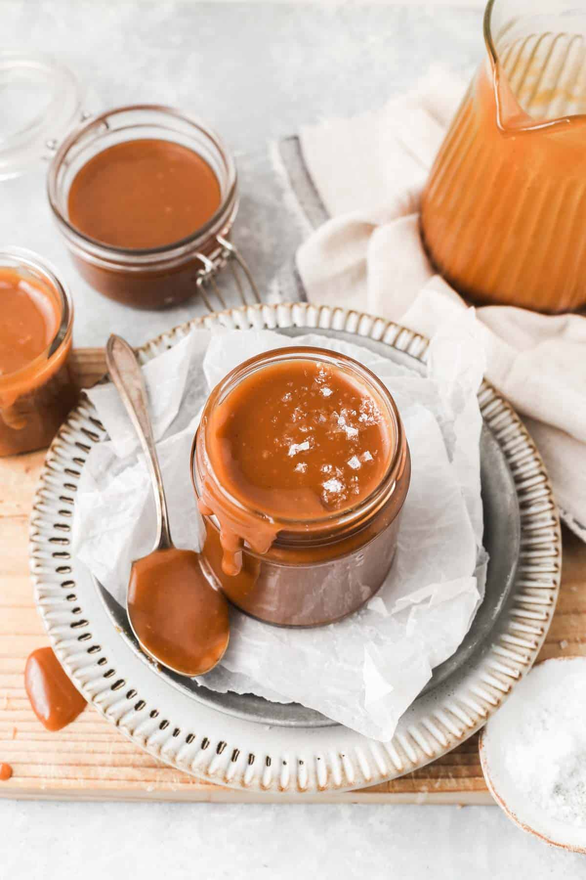 Jar filled with caramel sauce and sprinkled with sea salt flakes