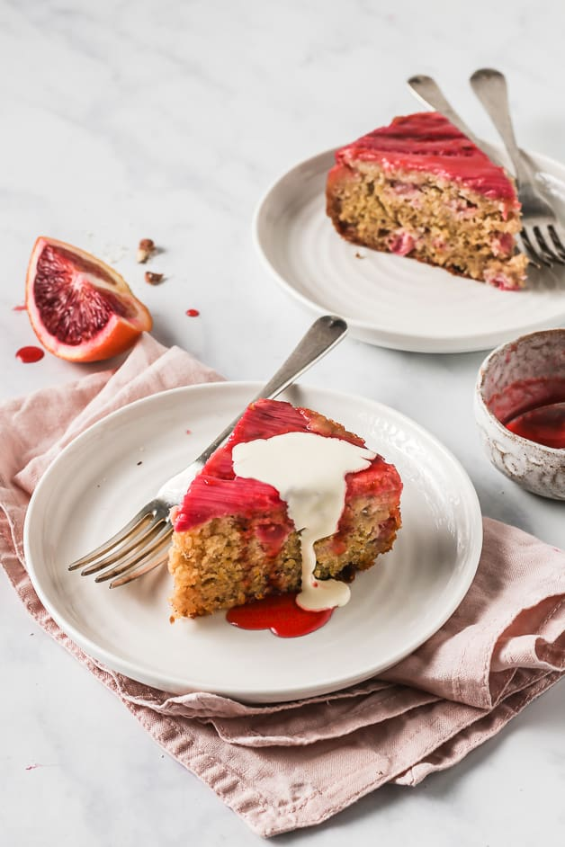 Upside Down Cake recipe cut into slices and served with cream