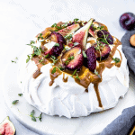 Fruit topped meringue drizzled with a toffee sauce