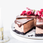Slice of Triple Chocolate Cheesecake on a cake stand by Emma Duckworth Bakes