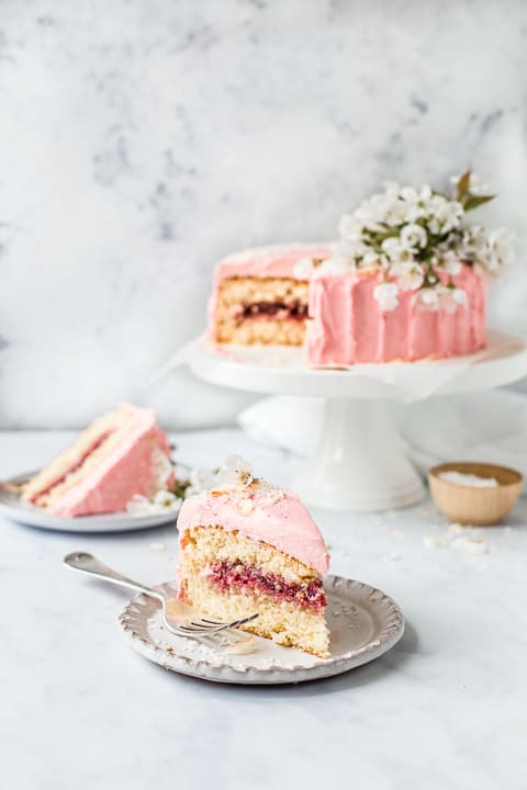 Slices of coconut cake with pink frosting
