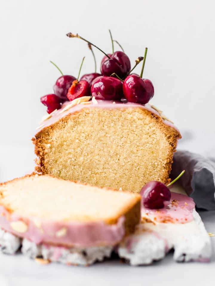 Orange Blossom Loaf Cake decorated with cherries