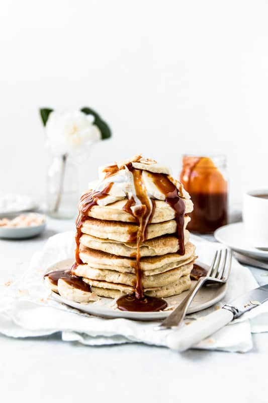 Stack of ricotta pancakes drizzled with salted caramel sauce
