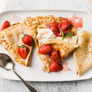 Crepes filled with strawberries and cream