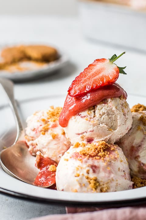 Bowl of ice-cream with strawberry sauce