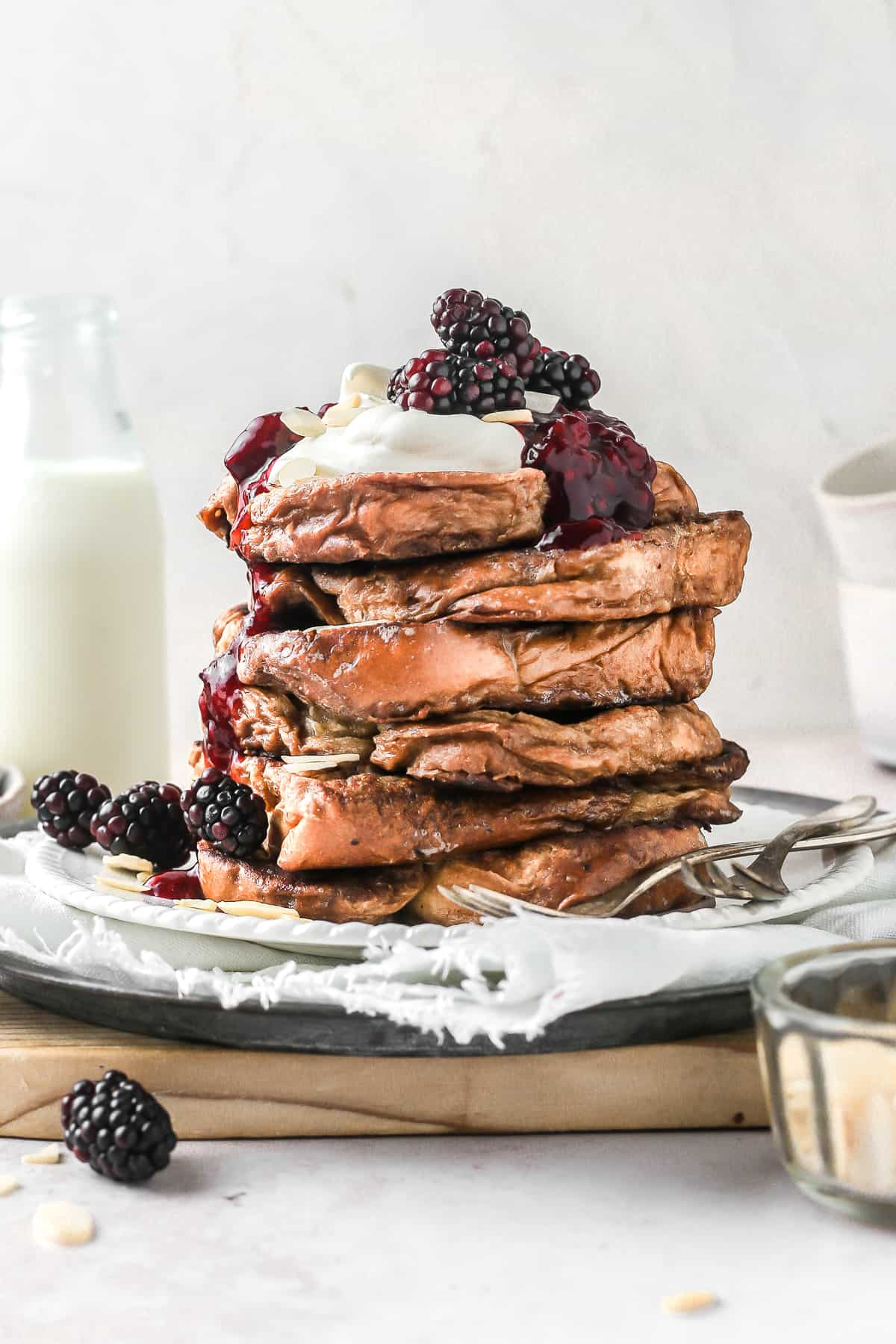 Brioche French Toast infused with Earl Grey and stacked on a plate
