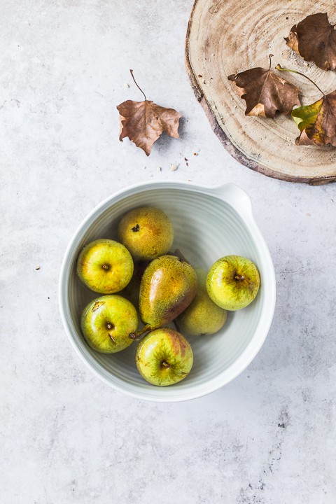 apples and pears in a bowl of water