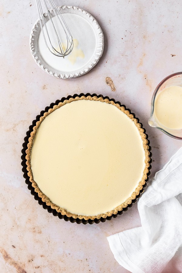 Pouring the custard into tart base