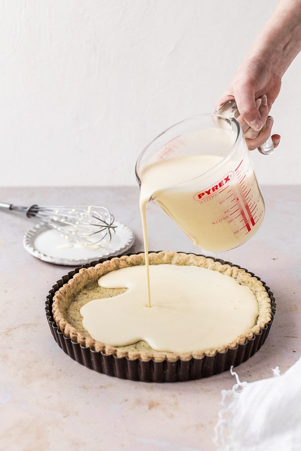 Pouring the custard into the tart base