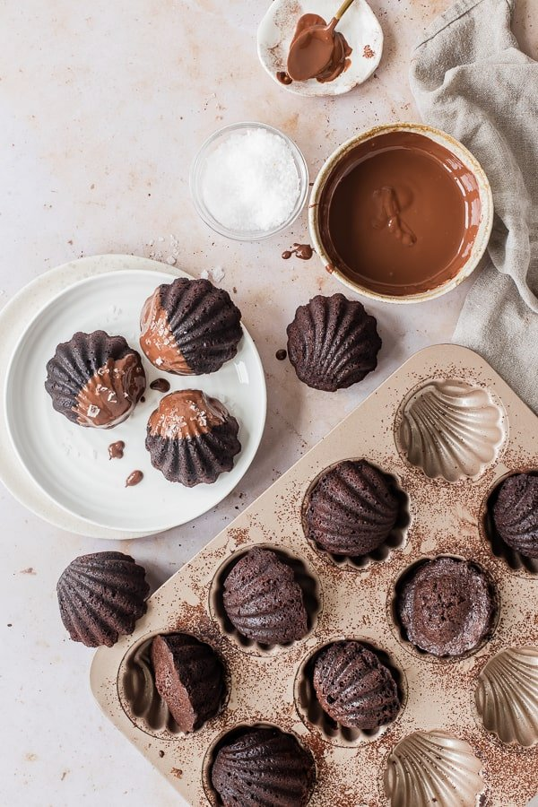 Dipping Madeleines into chocolate