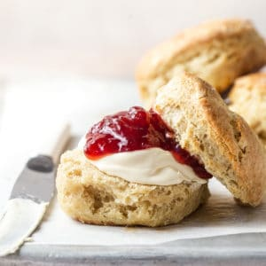 Small batch scones served with cream and jam
