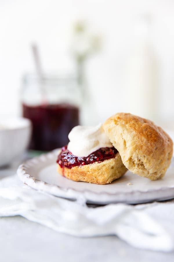 Scones topped with cream and jam