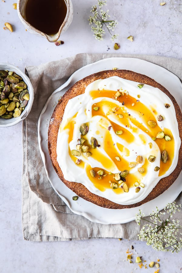 Cake served with syrup and pistachios