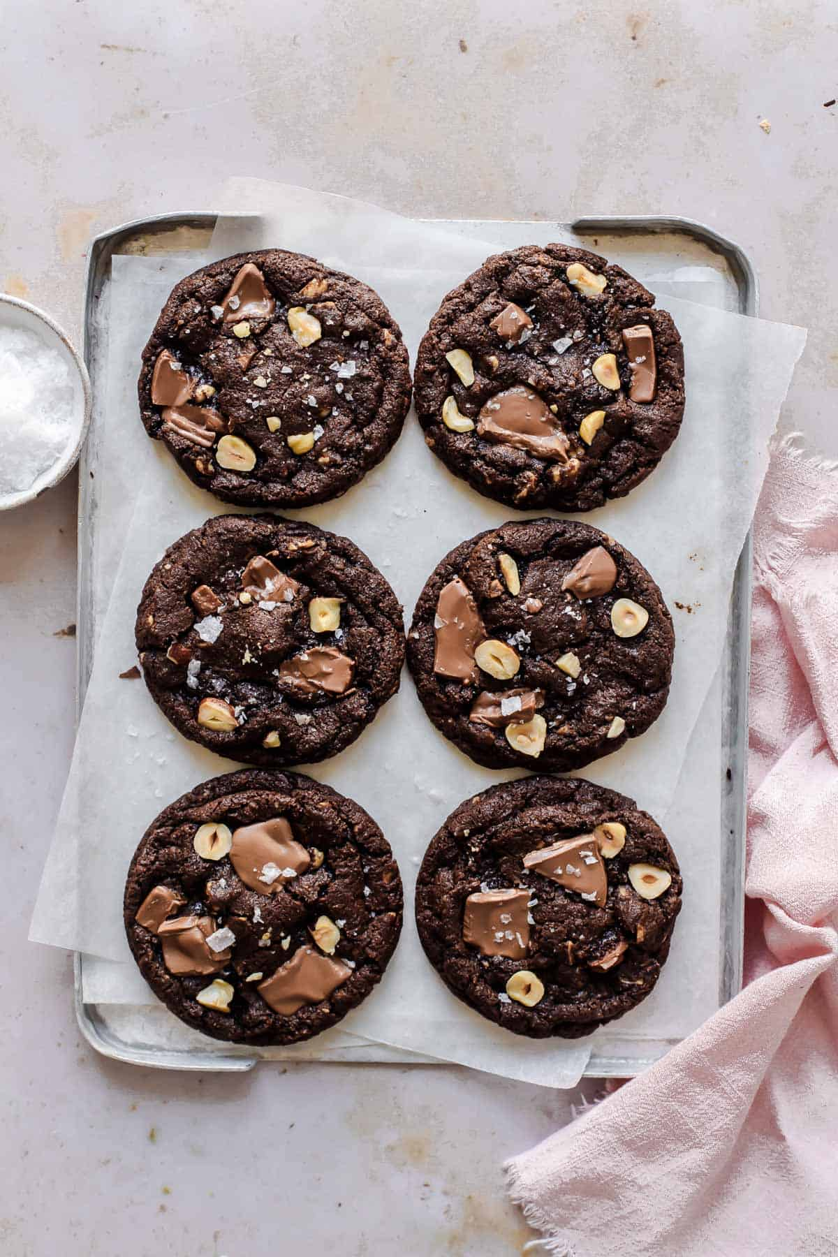 Chewy Chocolate and Hazelnut Cookies on a baking tray fresh from the oven