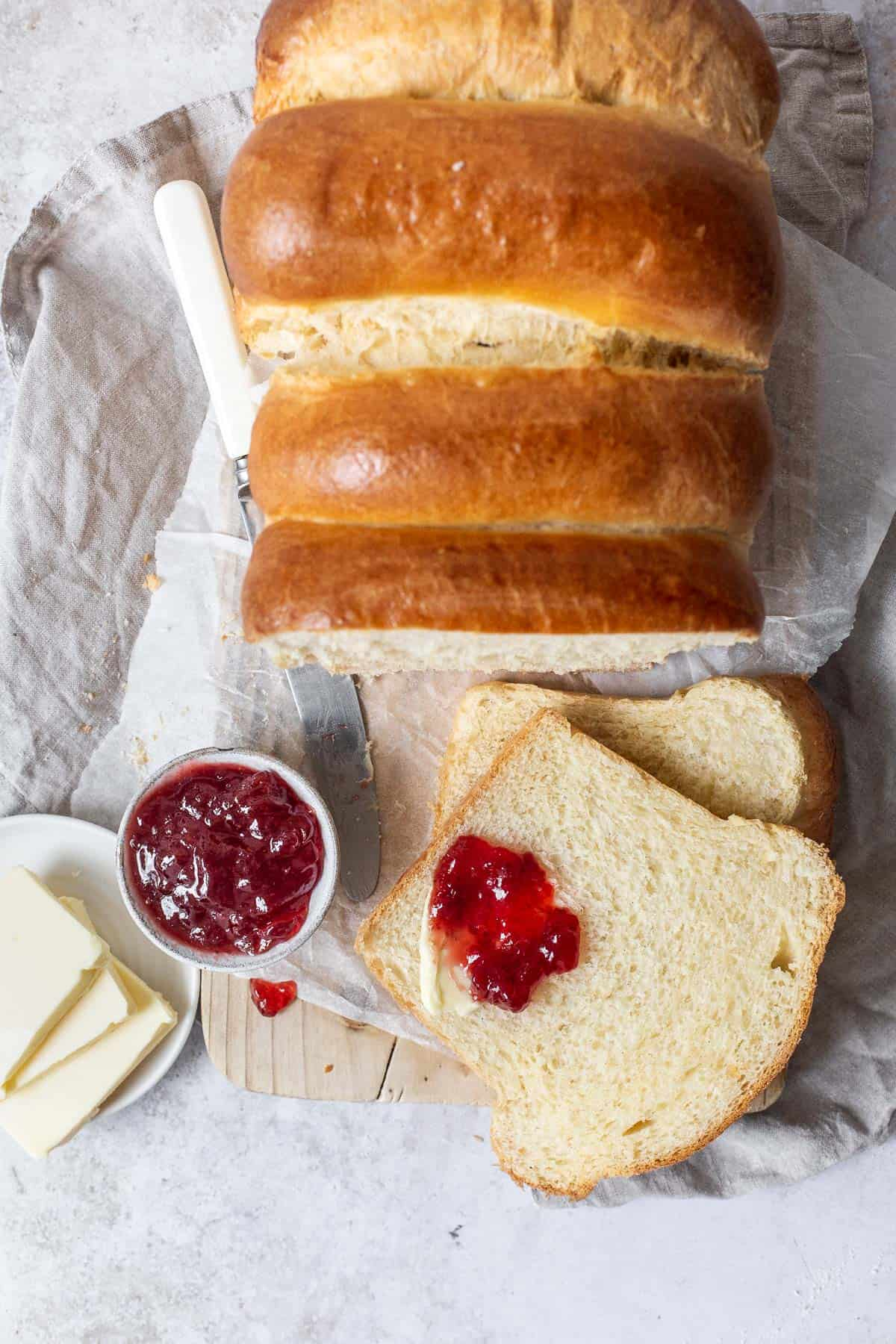 Golden Enriched Brioche Bread, sliced and served with jam for breakfast