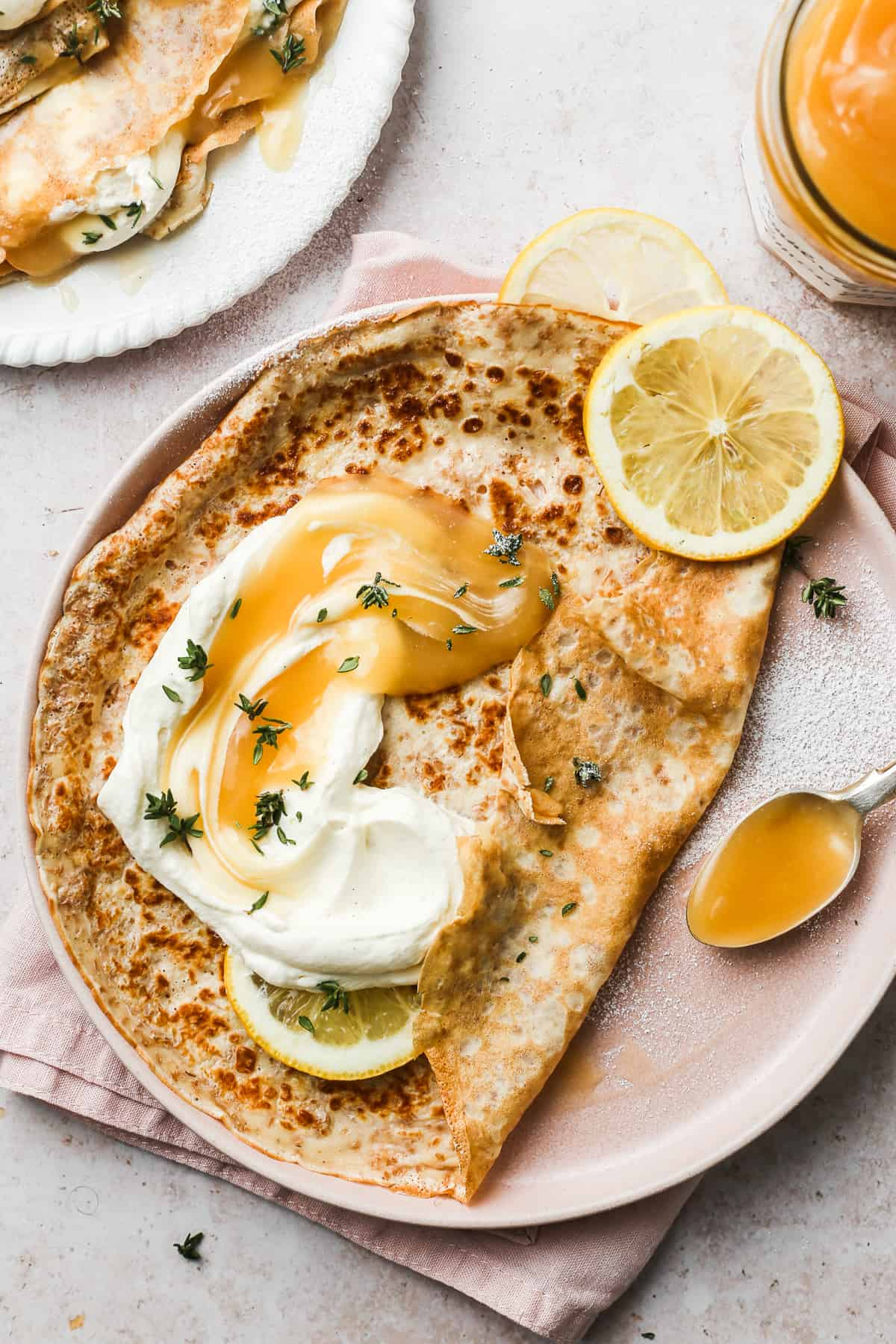 Whole Wheat Crêpes with Lemon Curd on a pink plate