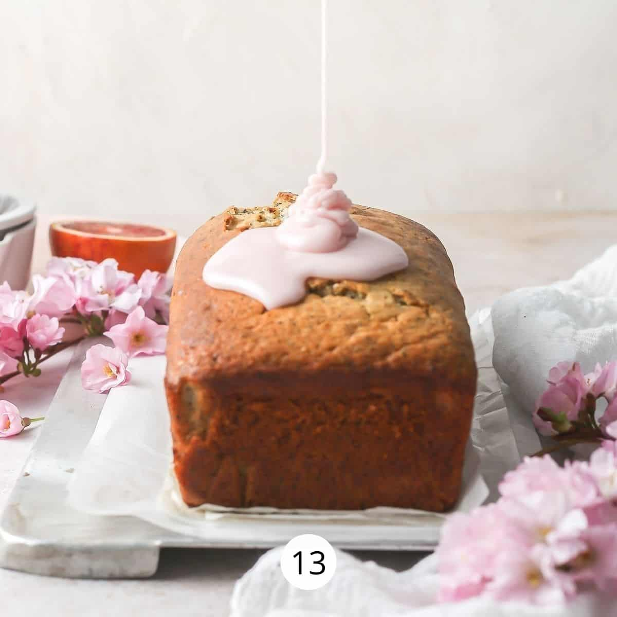 Drizzle being poured onto a loaf cake on a serving plate