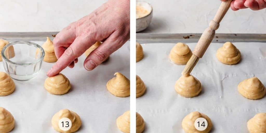 Preparing choux mounds- smoothing off top of mounds with wet finger and egg washing each mound.