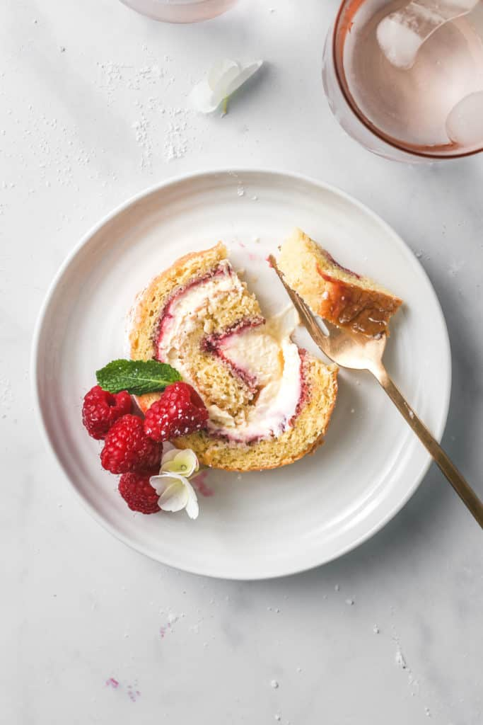 Slice of Raspberry Swiss Roll on a white plate