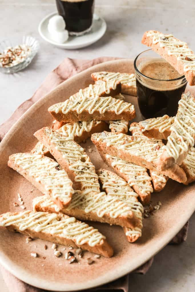 How to make biscotti - almond biscotti on pink platter served with coffee